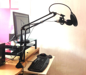 Photo of TONOR arm stand holding the ATR 2100 USB microphone