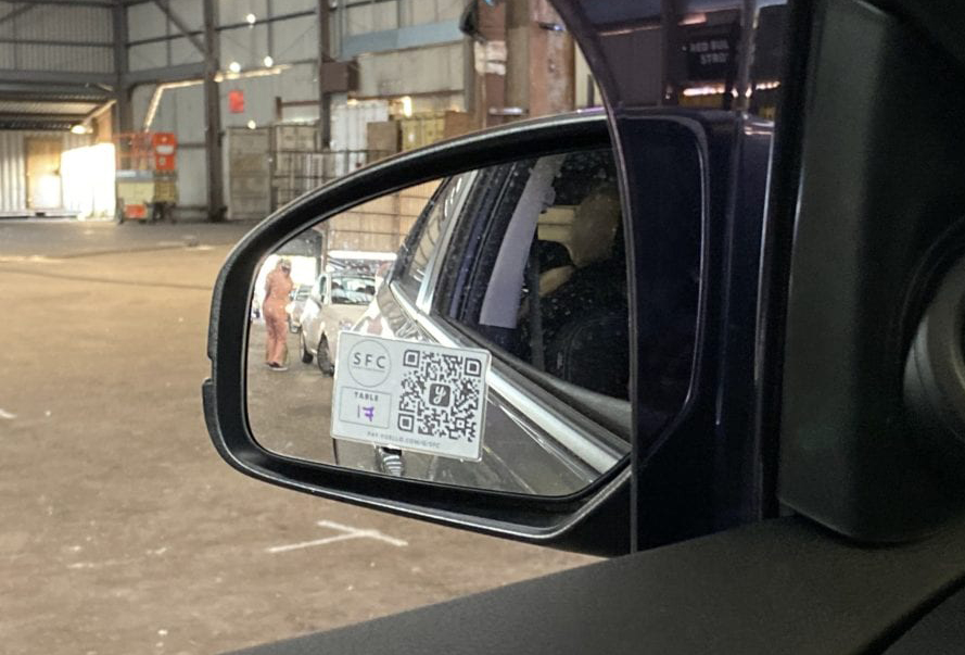 Photo of QR code fixed to car wing mirror