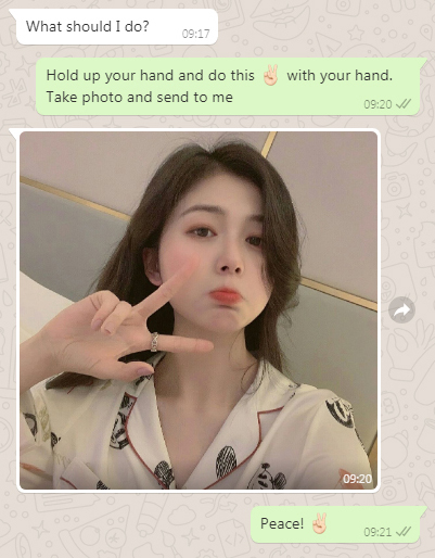 Screenshot of a WhatsApp text conversation with photo of girl making peace symbol
